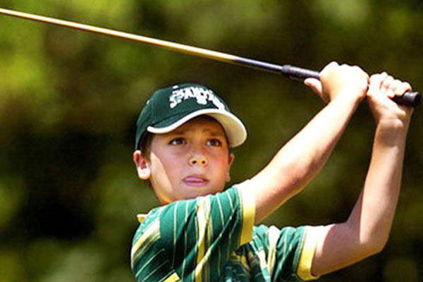 Boy golf swing
